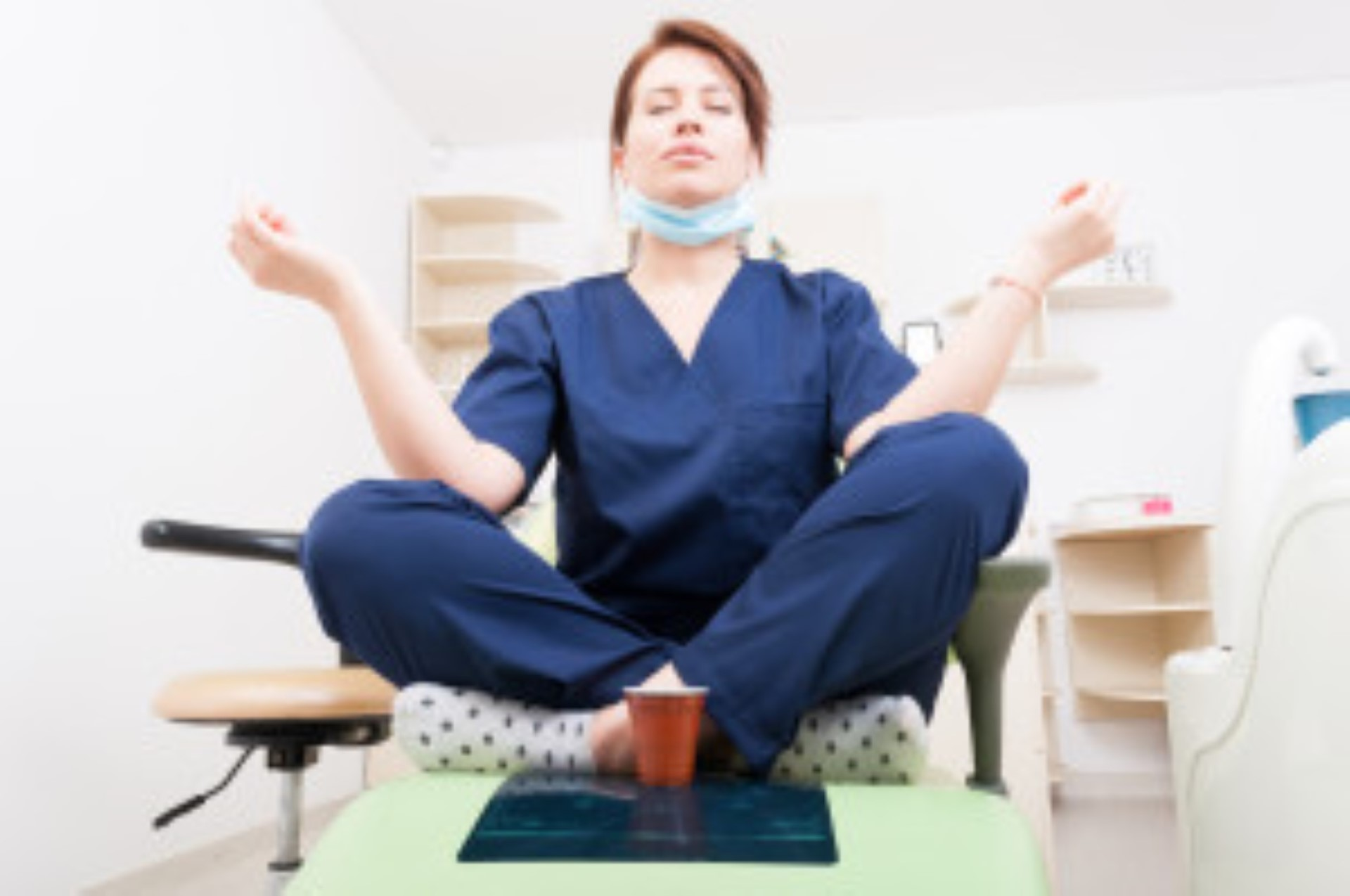 Dentist woman meditating with yoga and lotus position